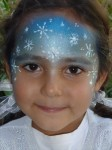 Frozen face painting design with white glitter gel