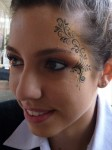 Face painting design with gold Liquid Bling