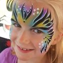 Queen face painting by Erika Nowak using SOBA Queen A-nu Ra stencil