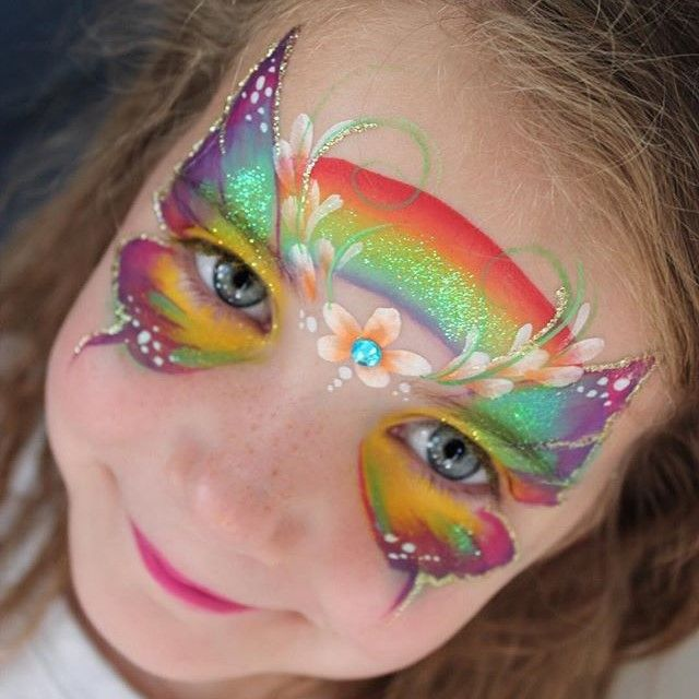 Butterfly face painting design with Gold Glitter Gel outline