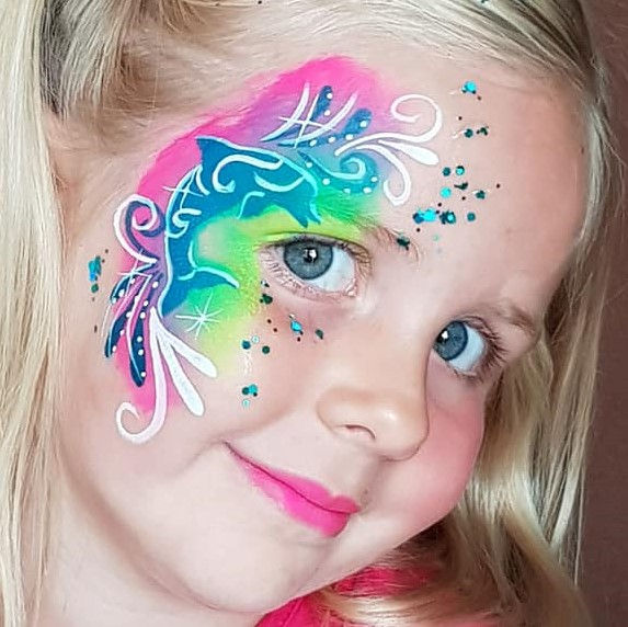 Dolphin face painting design by Bernice Gerssen using Diva stencil