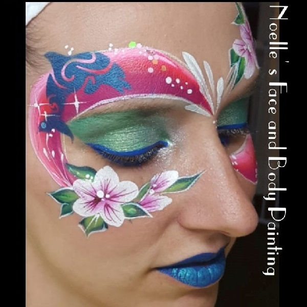 Dolphin face painting design by Noelle Perry using Diva stencil