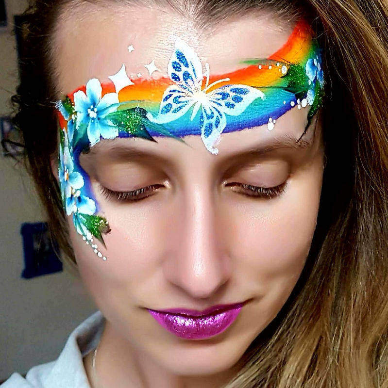 Two-step butterfly face painting design by Noelle Perry using Diva stencil