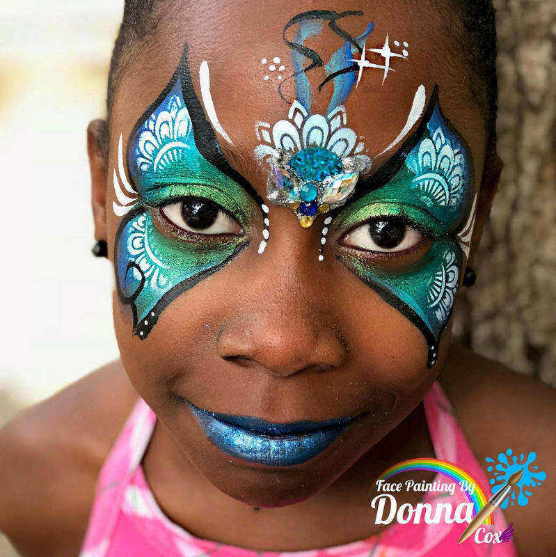 Butterfly face painting design by Donna Cox using Diva Henna stencil