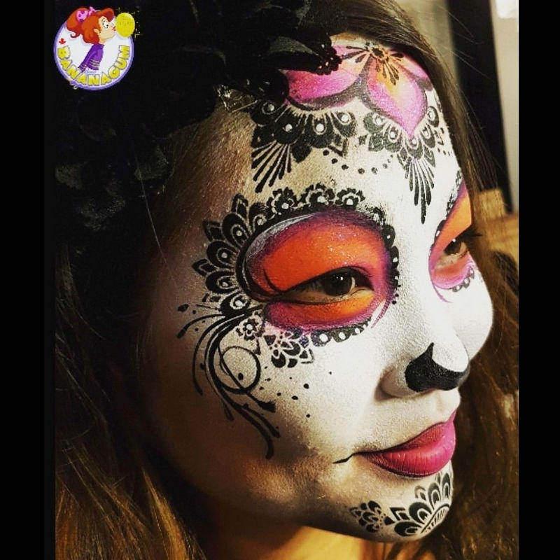 Sugar skull face painting design by Mai Park using Diva Henna stencil