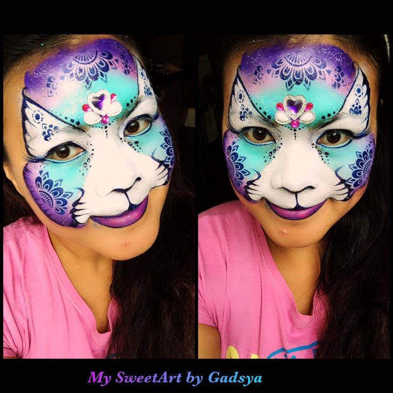 Cat face painting design by Gadsya Nggadas using Diva Henna stencil