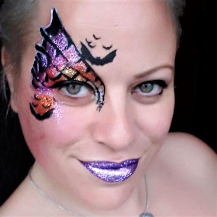 Bats Halloween face painting design by Kim van Nieuwaal using Diva stencil