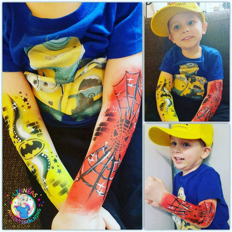 Batman and Spiderman face painting design by Linnea Onnerby Novak using Diva stencil