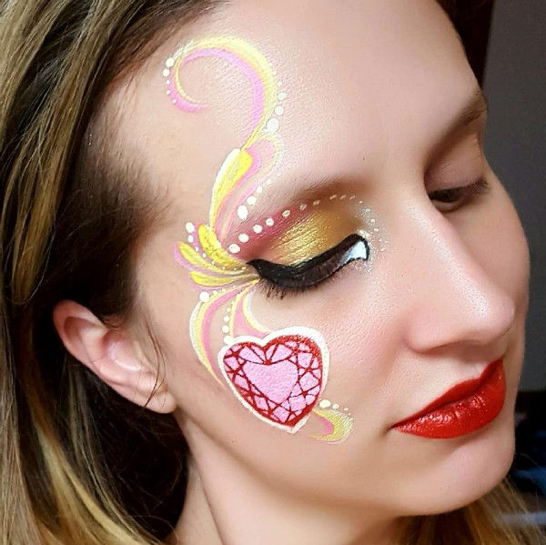 Heart gem face painting design by Noelle Perry using Diva stencil 727