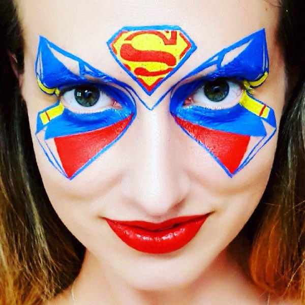 Superman face painting design by Noelle Perry using Diva stencil