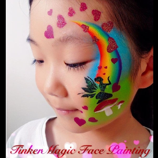 Love fairy face painting design by Nancy Wu using Diva stencil