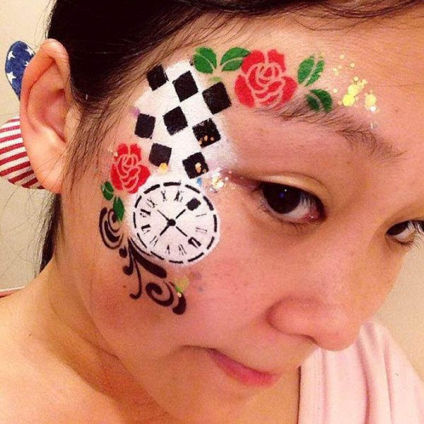 Alice in Wonderland face painting design by Nancy Wu using Diva stencil