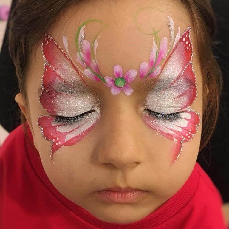 Butterfly face painting design with Silver Glitter Gel outline