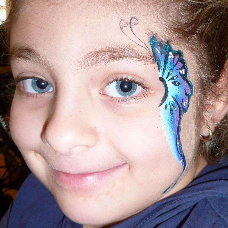 Butterfly face painting with Blue and Silver Glitter Gel highlights on TAG Dolphin One-stroke
