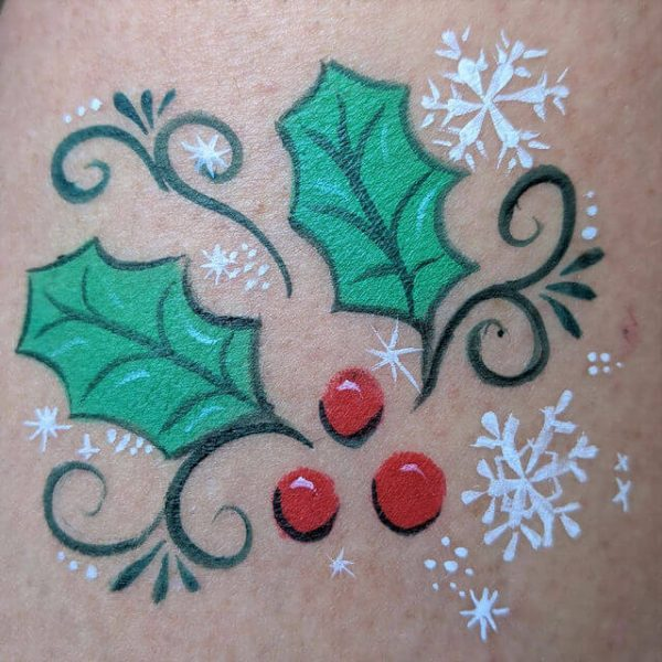 Christmas Holly using Holly stencil from Face Paint World