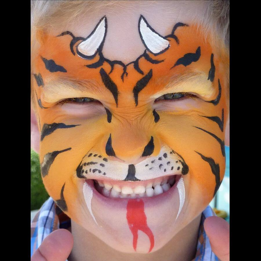 Dragon-Tiger face painting using Flora brush for stripes, nostrils, horns and fangs