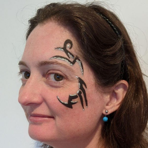 Stencilled Tribal Eye Face Painting with Silver glitter gel
