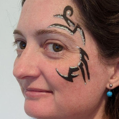 Stencilled Tribal face painting with Silver glitter gel