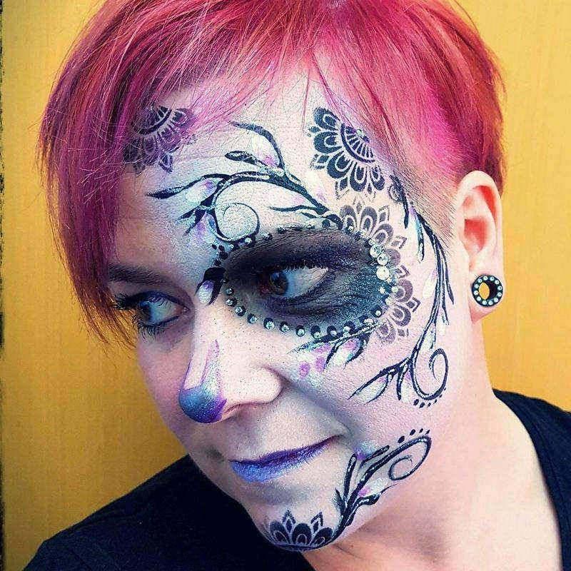 Sugar skull face painting design by by Petra Knafl using Diva stencil
