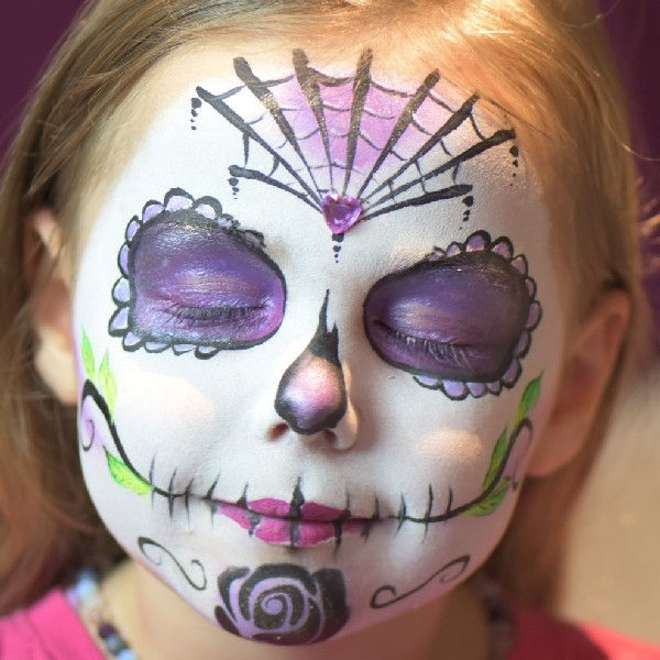Sugar skull face painting design with Diva rose stencil