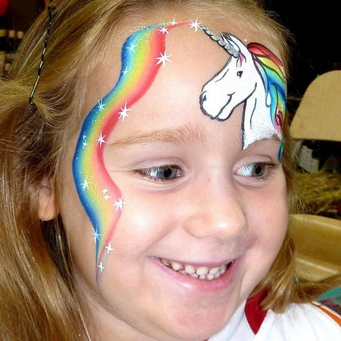 Unicorn face painting design with Silver Glitter Gel unicorn horn and Rainbow Lorikeet one-stroke