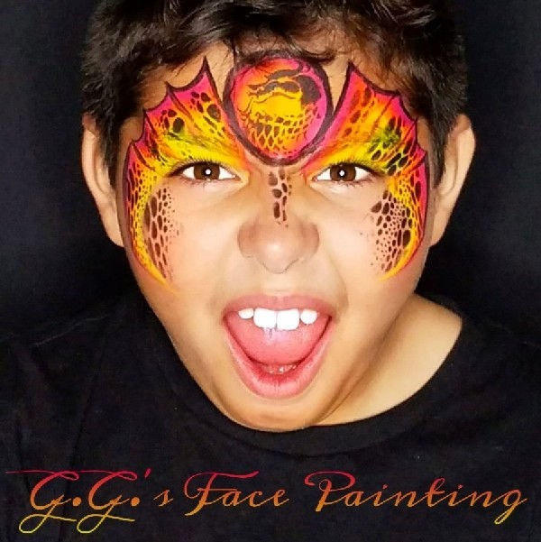 Wicked dragon face painting design by Gio Guzman using Diva stencil