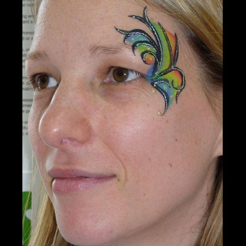 abstract face painting design with Silver glitter gel highlights and Gold glitter gel dots